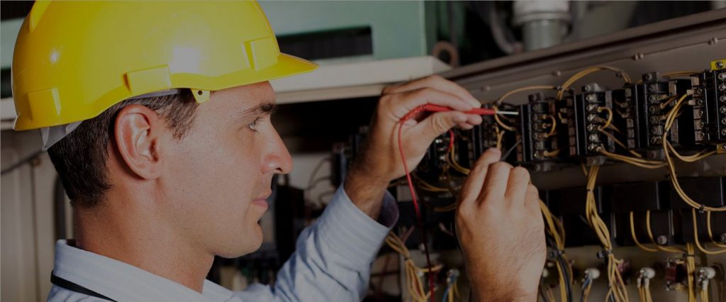 Electrician Services - Sternberg Electric - St Paul, MN - Man Testing Panel